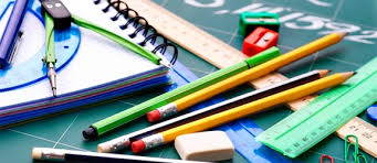 Photo of school supplies including pens, pencils, protractor, rulers and notebooks.