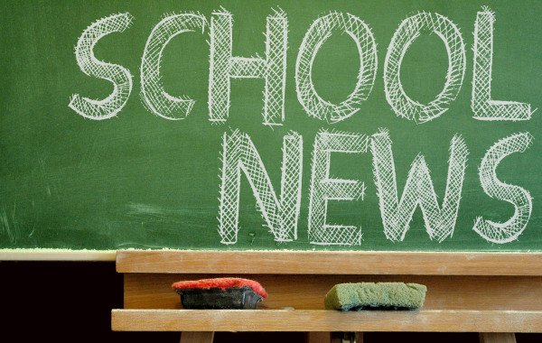 School News written in white chalk on a green chalk board