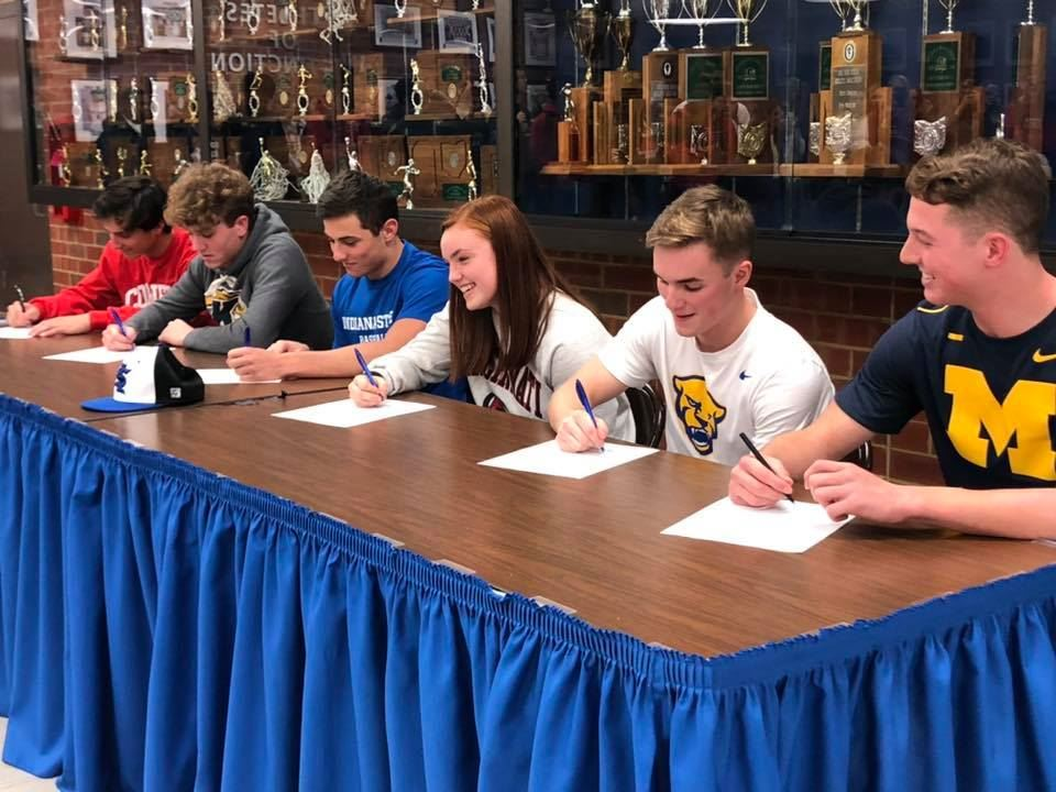 Six Comet athletes signing their letters of intent