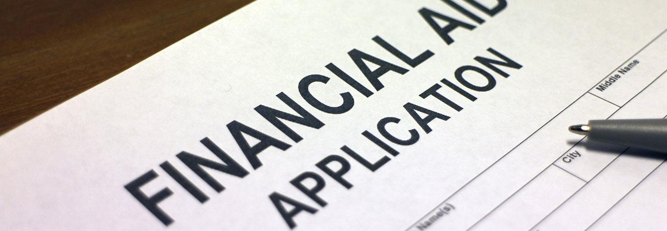 Financial aid application with pen