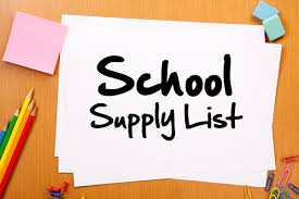 School supply list on wood desk with colored pencils, paper clips and other supplies