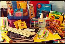 School supplies including pens, pencils, scissors, notebooks, glue