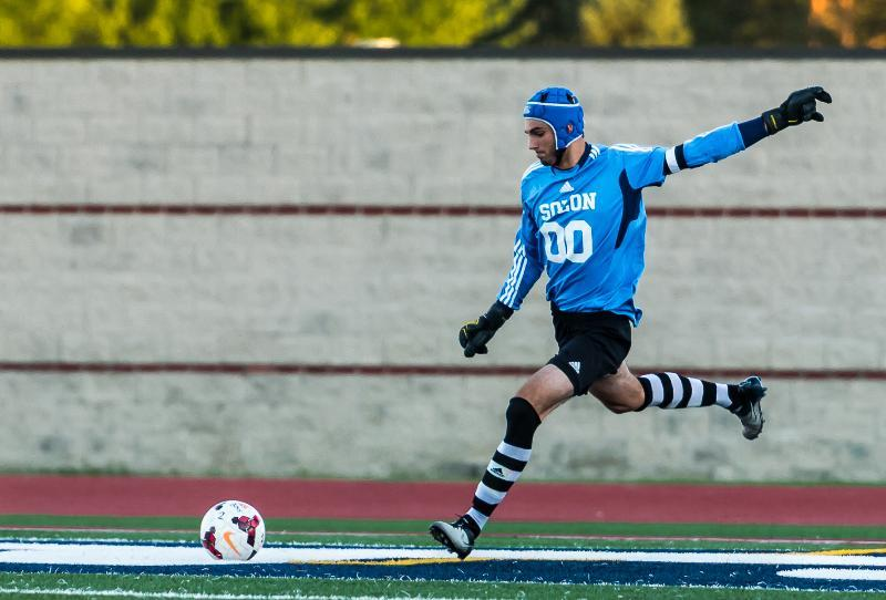 Senior Goalkeeper John Lombardo serves the ball up on a goal kick.